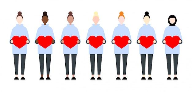 Set różnorodne biegowe wektorowe kobiety trzyma serca. walentynki siostrzany śliczny i prosty płaski styl