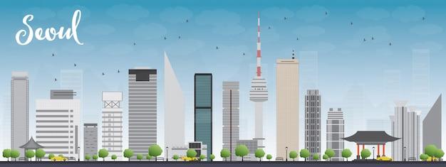 Seul linia horyzontu z szarym budynkiem i niebieskim niebem