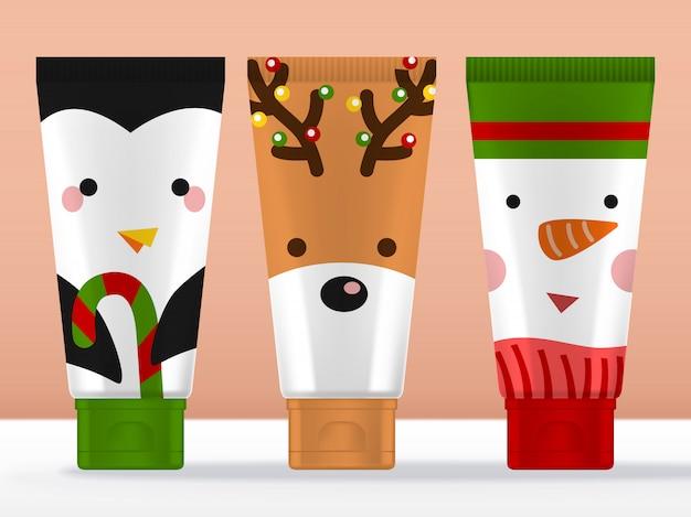 Sezonowy prezent powitalny, świąteczne znaki opakowanie kremowej tubki z maskotkami pingwina, renifera i bałwana.