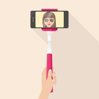 Sfotografuj dziewczynę przez telefon za pomocą kija selfie. media społecznościowe. nastolatek patrząc na kamery i robić zdjęcie