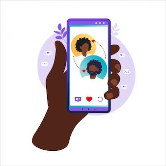 Sieci społecznościowe, czatowanie, aplikacja randkowa. ilustracja wektorowa dla użytkowników aplikacji randkowej. płaskie ilustracja znajomość afrykańskiego mężczyzny i kobiety w sieci społecznościowej. ilustracja wektorowa w mieszkaniu.