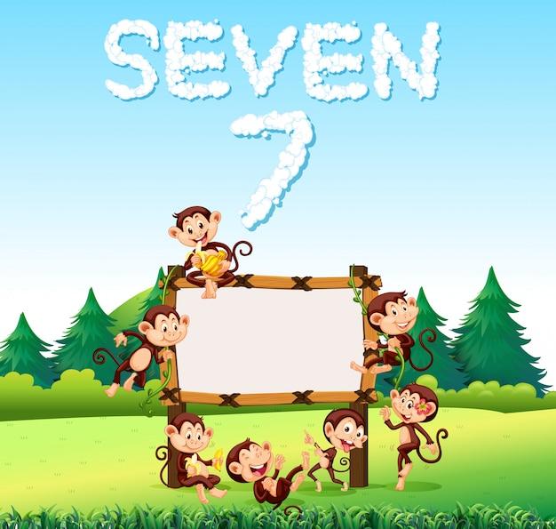 Siedem małpy na drewnianej desce