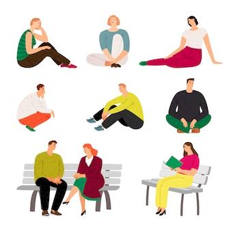 Siedzący i relaksujący przypadkowi mężczyźni i kobiety