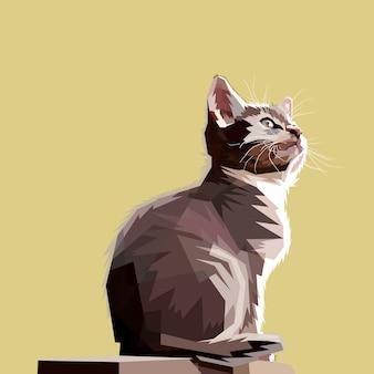 Siedzący kot wygląda, mając nadzieję