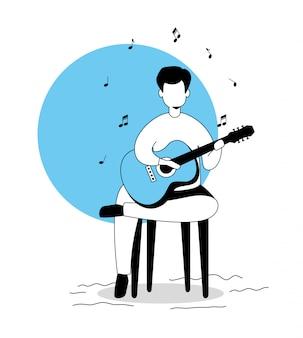 Siedzący mężczyzna gra na gitarze
