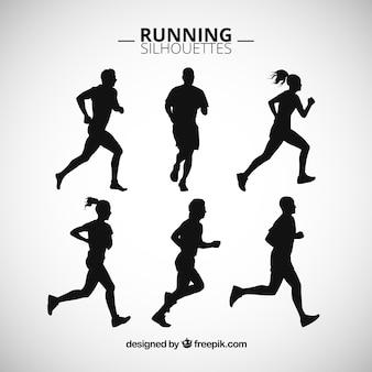 Silhouettes ludzi biegnie