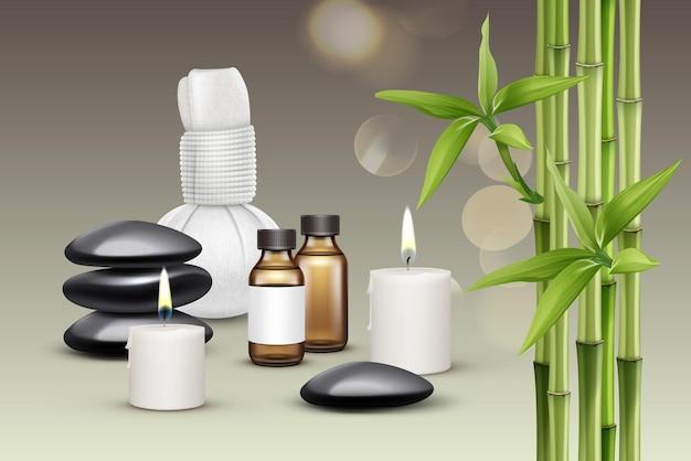 Skład akcesoriów do masażu. olej, świece, kamienie, kompres ziołowy, aromat, bambus.