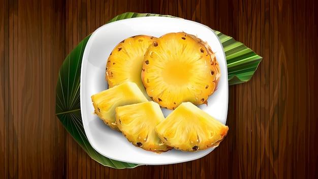 Skład ananasa na białym talerzu i liściu.