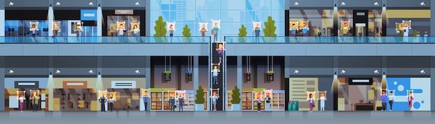 Sklep detaliczny identyfikacja gości rozpoznawanie twarzy nowoczesne centrum handlowe wnętrze kamery bezpieczeństwa system nadzoru cctv