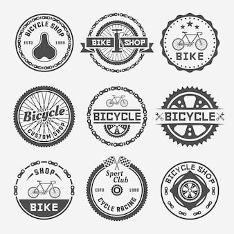 Sklep rowerowy zestaw monochromatycznych okrągłych etykiet, odznak lub emblematów w stylu vintage