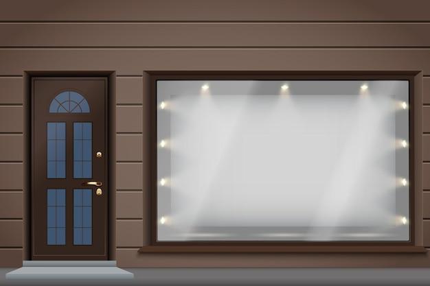 Sklepowa fasada zewnętrzna z dużą szklaną witryną i drzwiami.