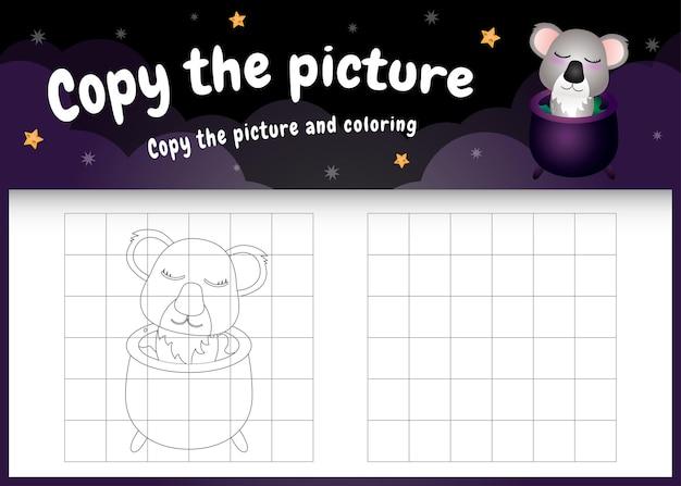 Skopiuj obrazek dla dzieci i stronę do kolorowania z uroczą koalą za pomocą kostiumu na halloween