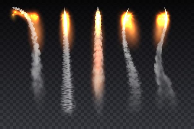 Ślady dymu z ognia rakietowego, tory startowe statków kosmicznych