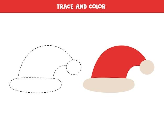 Śledź i pokoloruj uroczą czapkę świętego mikołaja. arkusz dla dzieci.