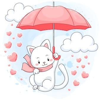 Śliczna biała figlarka unosi się na różowym parasolu