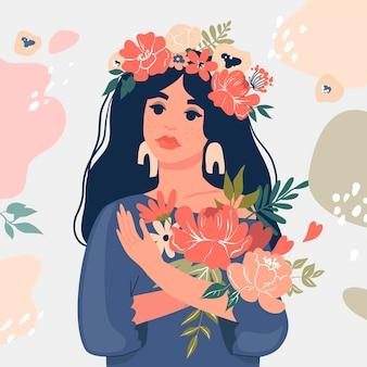 Śliczna czarna dziewczyna trzyma bukiet kwiatów.