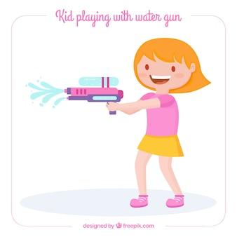 Śliczna dziewczyna bawić się z wodnym pistoletem