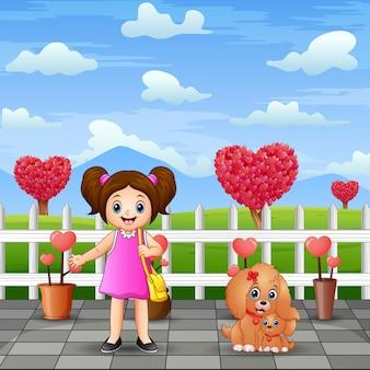 Śliczna dziewczyna i jej zwierzak w krajobrazie parku
