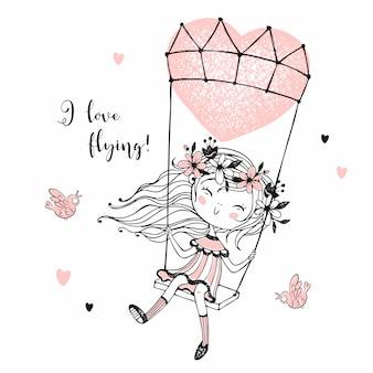 Śliczna dziewczyna lata na balonie w postaci serca.