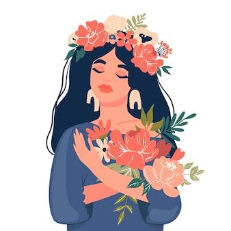 Śliczna dziewczyna trzyma bukiet kwiatów.