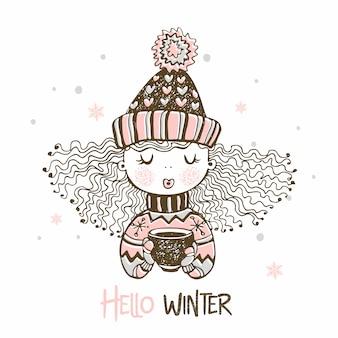 Śliczna dziewczyna w trykotowym kapeluszu i mitenkach pije gorącą kawę. witaj zimo.