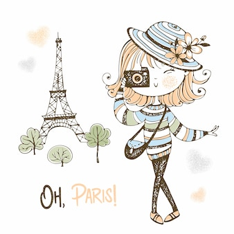 Śliczna dziewczyna z kamerą w paryż. podróżować.