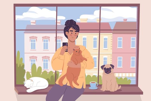 Śliczna dziewczyna z kotami i zabawnym mopsem siedzącym przy oknie