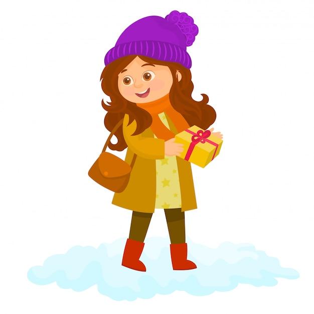 Śliczna dziewczyna z prezentem. zimowy czas.