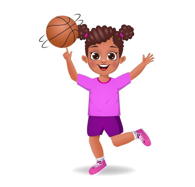 Śliczna dziewczynka kręci piłkę na czubku palca