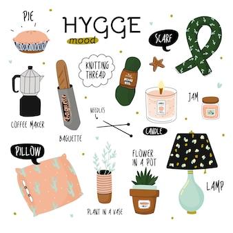 Śliczna ilustracja elementów hygge jesienią i zimą. na białym tle. motywacyjna typografia cytatów hygge.