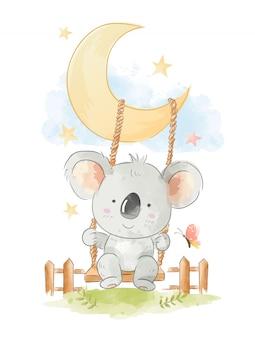 Śliczna koala jest usytuowanym na huśtawkowej ilustraci