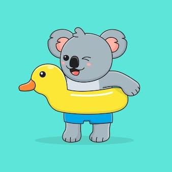 Śliczna Koala Z Gumową Kaczką Do Pływania Premium Wektorów