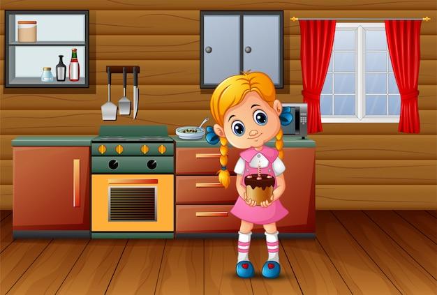 Śliczna kreskówka dziewczyna trzyma tort w kuchni