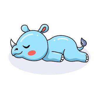 Śliczna kreskówka nosorożca w pozycji leżącej