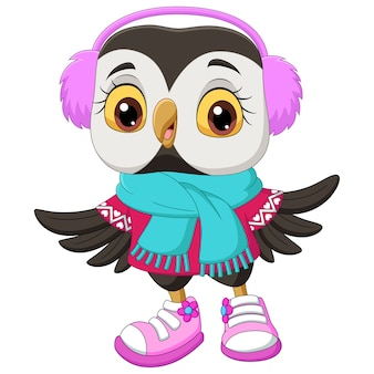 Śliczna kreskówka sowa ubrana w szalik i futrzane słuchawki