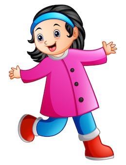 Śliczna kreskówki dziewczyna w zim ubrań machać