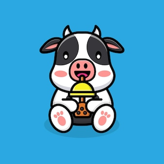 Śliczna krowa pijąca herbatę boba