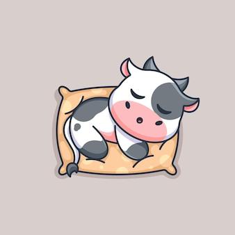 Śliczna krowa śpiąca na poduszce kreskówka