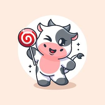 Śliczna krowa trzymająca kreskówkę lizaka