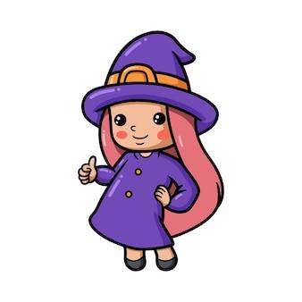 Śliczna mała czarownica dziewczyna kreskówka daje kciuk w górę