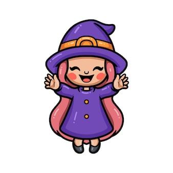 Śliczna mała czarownica dziewczyna kreskówka podnosząc ręce