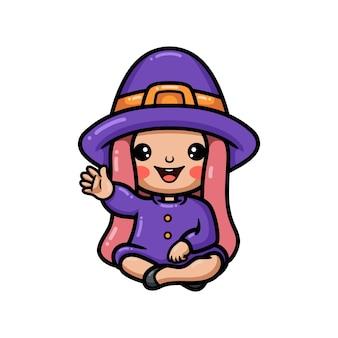 Śliczna mała czarownica dziewczyna kreskówka siedzi