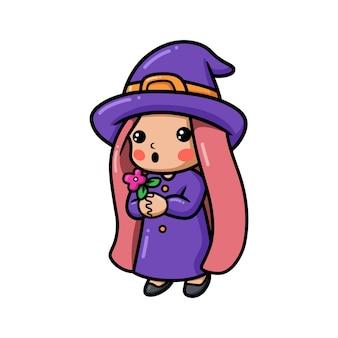 Śliczna mała czarownica dziewczyna kreskówka trzyma kwiat