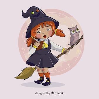 Śliczna mała dziewczynka czarownica z sową