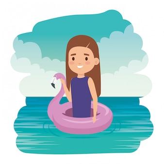 Śliczna mała dziewczynka dama z flamandzkim pływakiem w morzu
