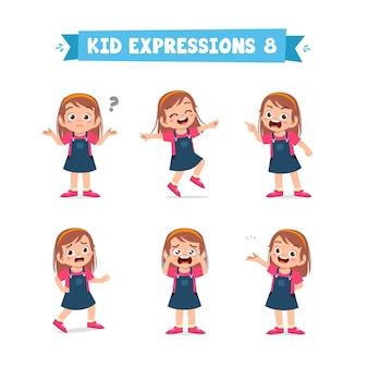 Śliczna mała dziewczynka w różnych zestawach wyrażeń i gestów