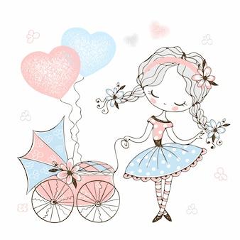 Śliczna mała dziewczynka z zabawkarskim wózkiem dziecięcym z dzieckiem.