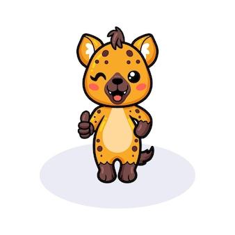 Śliczna mała hiena kreskówka daje kciuk w górę