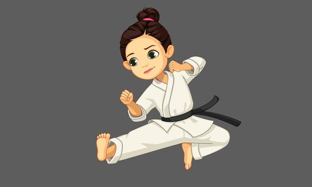 Śliczna mała karate dziewczyna w karate