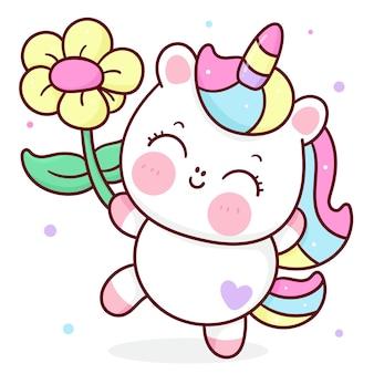 Śliczna mała kreskówka jednorożca trzymająca kwiat kawaii zwierząt